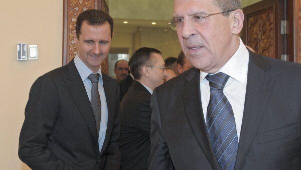 Президент Сирии Башар Асад и глава МИД РФ Сергей Лавров во время встречи в резиденции президента в Дамаске