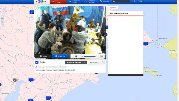 Скрин-шот с камеры видеонаблюдения на выборах президента РФ