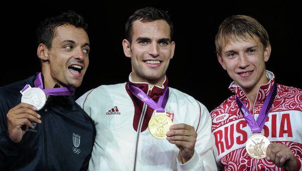 Итальянец Диего Оккьюцци, спортсмен из Венгрии Арон Силадьи и россиянин Николай Ковалев