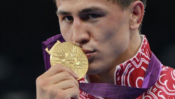 Российский борец Роман Власов, завоевавший золотую медаль