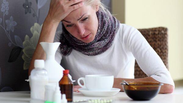 Женщина борется с гриппом. Архивное фото