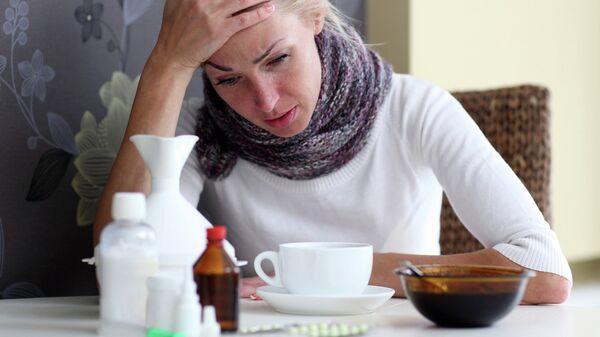 Женщина борется с гриппом. Архив