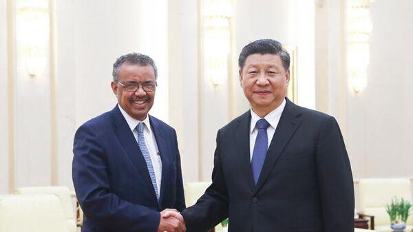 Председатель КНР Си Цзиньпин на встрече с генеральным директором Всемирной организации здравоохранения (ВОЗ) Тедросом Аданомом Гебреисусом в Доме народных собраний в Пекине