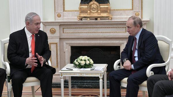 Президент РФ Владимир Путин и премьер-министр Израиля Биньямин Нетаньяху во время встречи