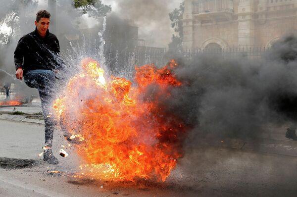 Демонстрант на Акции протеста в Вифлееме