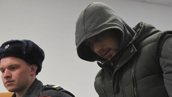 Бывший сотрудник полиции Максим Уметбаев перед началом заседания Басманного суда города Москвы
