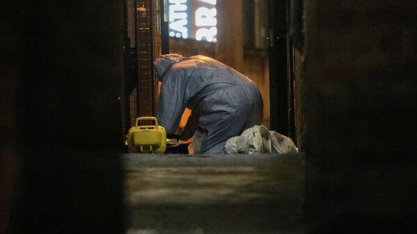 Судмедэксперт  на месте происшествия в районе Стретэм, Лондон. 2 февраля 2020