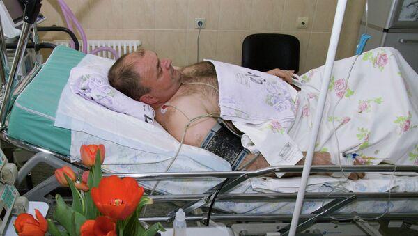 Майор полиции Юрий Седых, раненый при задержании подозреваемого в убийстве шести человек С.Помазуна
