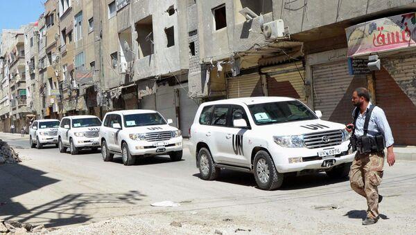 Колонна машин с инспекторами ООН по химическому оружию в Дамаске. Архивное фото