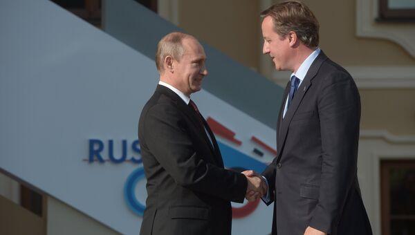 Президент России Владимир Путин и премьер-министр Великобритании Дэвид Кэмерон