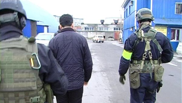 Задержание подозреваемых в распространении радикальной религиозной идеологии. Фото с места события