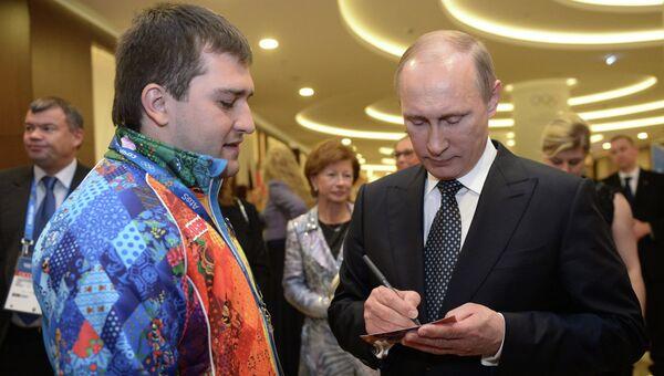 В.Путин встретился с волонтером И. Радько