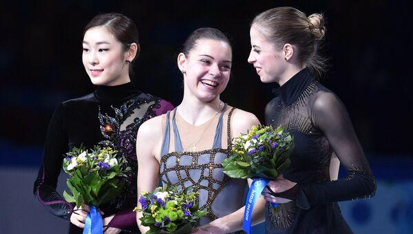 Ким Ю На (Южная Корея) - серебряная медаль, Аделина Сотникова (Россия) - золотая медаль, Каролина Костнер (Италия) - бронзовая медаль