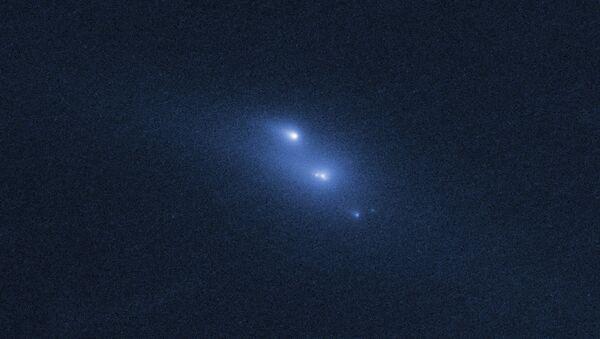 Распад астероида P/2013 R3