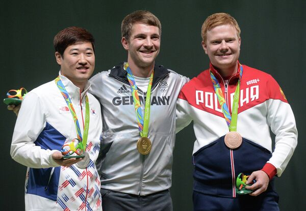 Ким ДжонХён (Южная Корея), Хенри Юнгхенель (Германия) и Кирилл Григорьян (Россия) (слева направо)