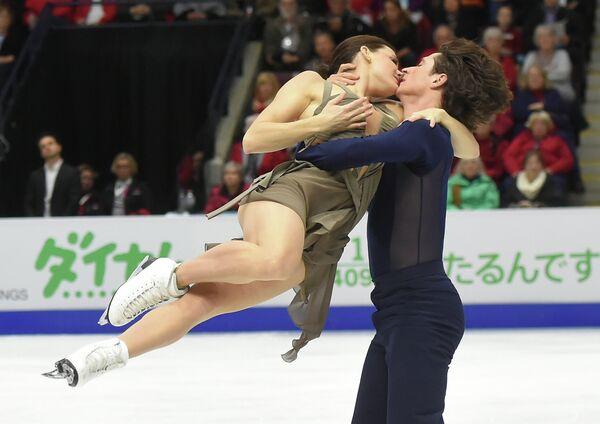 Произвольный танец канадских фигуристов Тессы Вирчу и Скотта Мойра