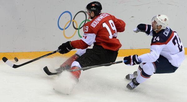 Игровой момент матча олимпийского хоккейного турнира США - Канада