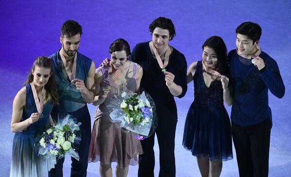 Габриэлла Пападакис и Гийом Сизерон (Франция), Тесса Вирчу и Скотт Мойр (Канада) и Майя Шибутани и Алекс Шибутани (США) (слева направо)