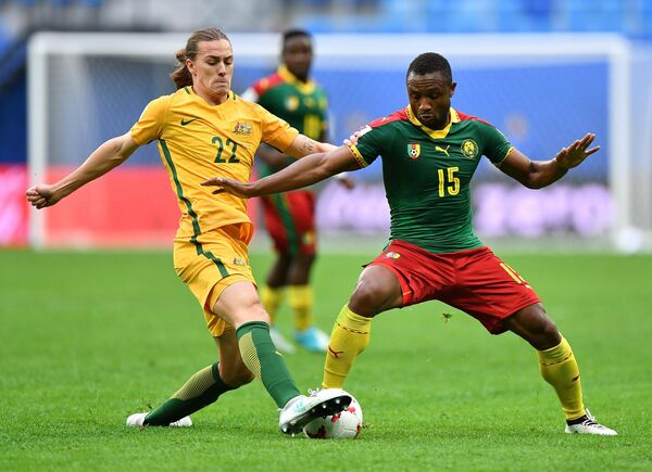 Слева направо: Джексон Ирвин (Австралия) и Себастьян Сиани (Камерун)