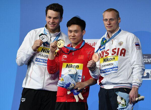 Илья Захаров, Се Сыи и Патрик Хаусдинг (справа налево)