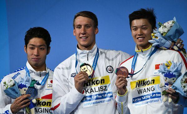 Косуке Хагино, Чейз Калиш, Ван Шунь (слева направо)