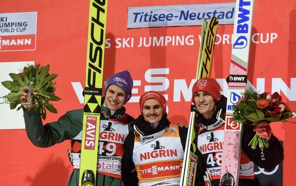 Немцы Рихард Фрайтаг и Андреас Веллингер и норвежец Даниэль-Андре Танде (слева направо)