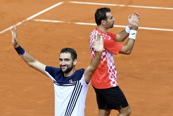 Хорватские теннисисты Марин Чилич и Иван Додиг (слева направо)