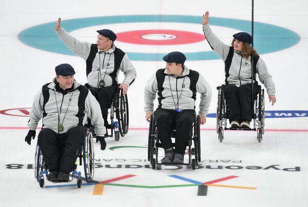 Российские атлеты Марат Романов, Константин Курохтин, Дарья Щукина и Андрей Мещеряков (слева направо)