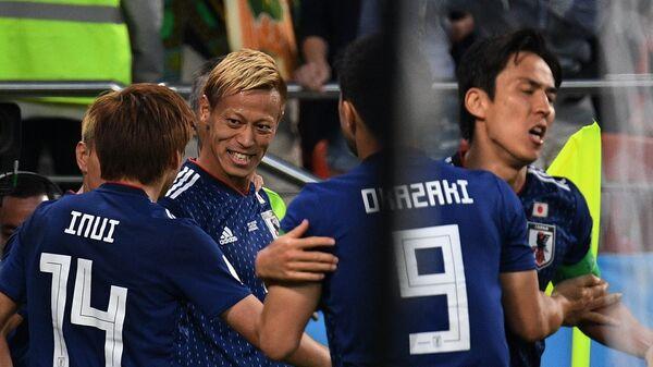 Футболисты сборной Японии Такаси Инуи, Кэйсукэ Хонда и Синдзи Окадзаки (слева направо)