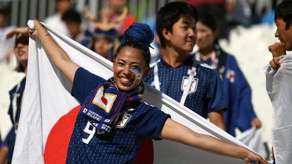 Болельщица сборной Японии перед матчем чемпионата мира между сборными Японии и Польши