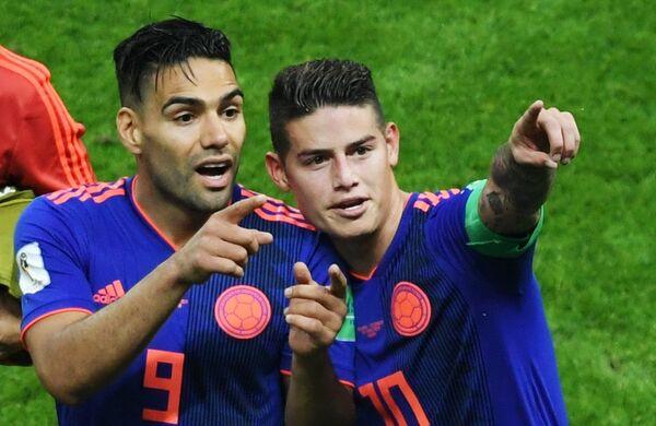 Футболисты сборной Колумбии Радамель Фалькао и Хамес Родригес (слева направо)