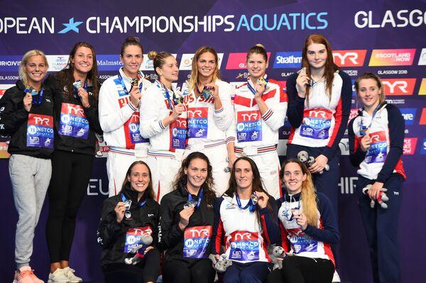 Пловчихи сборной Дании, пловчихи сборной России и пловчихи сборной Великобритании (слева направо)