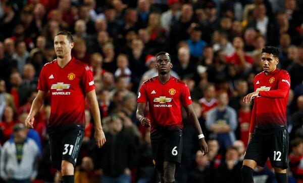 Футболисты Манчестер Юнайтед Неманья Матич, Поль Погба и Крис Смоллинг (слева направо)