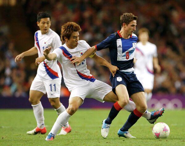 Игровой момент матча Великобритания - Южная Корея