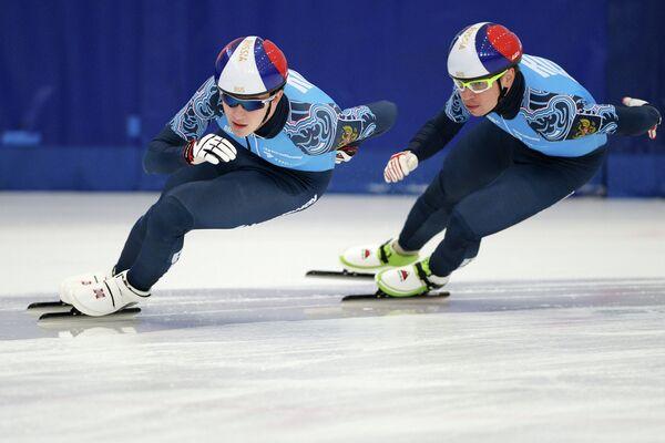 Российские спортсмены Дмитрий Мигунов (слева) и Евгений Козулин