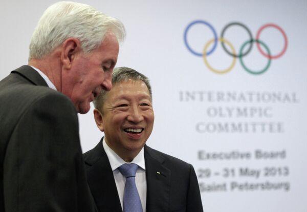 Член МОК Крэйг Риди и вице-президент МОК Нг Сер Мианг
