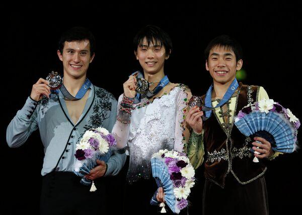 Канадец Патрик Чан и японцы Юдзуру Ханью и Нобунари Ода (слева направо)