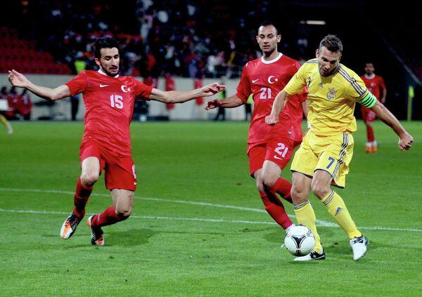 Мехмет Топал, Омер Топрак и Андрей Шевченко (слева направо)