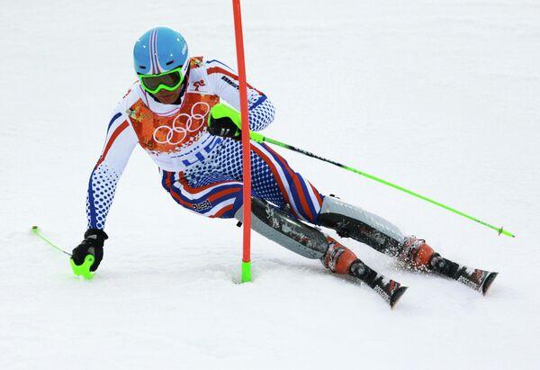 Сергей Майтаков (Россия) на трассе слалома в первой попытке на соревнованиях по горнолыжному спорту