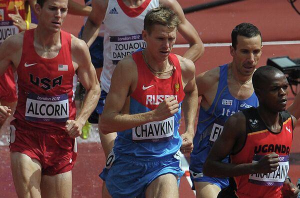 Российский спортсмен Николай Чавкин (в центре)