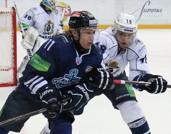 Рикард Йюнге и Александр Логинов (справа)