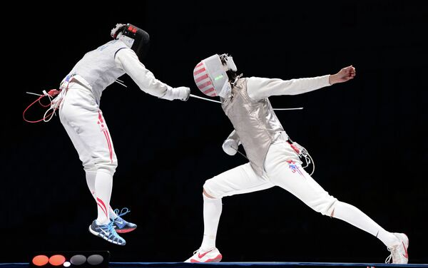 Юки Ота (Япония) и Александр Массиалас (США) (слева направо)