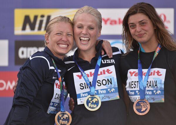 Сесиль Карлтон (США) - серебряная медаль, Рашель Симпсон (США) - золотая медаль, Яна Нестерова (Белоруссия) - бронзовая медаль (слева направо