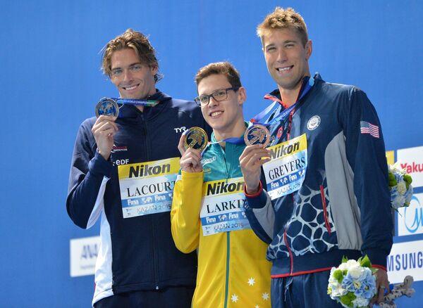 Камиль Лакур (Франция) - серебряная медаль, Мэтт Гриверс (США) - золотая медаль, Митчелл Ларкин (Австралия) - бронзовая медаль (слева направо)
