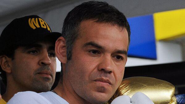 Жилберто Хесус Мендоса (слева)