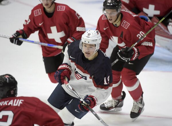 Игровой момент матча МЧМ между молодежными сборными Швейцарии и США