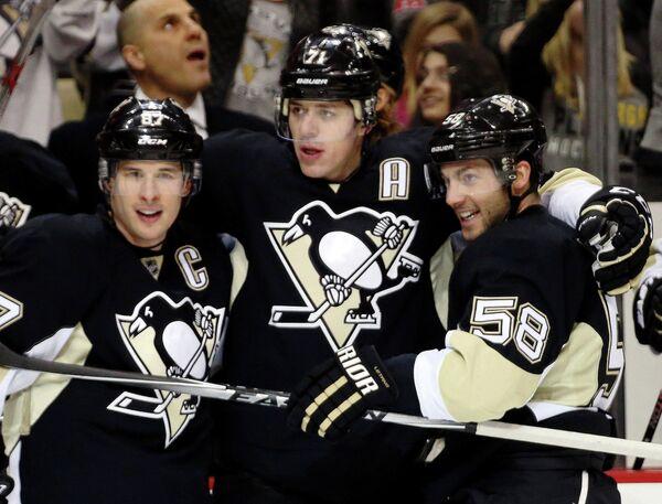 Хоккеисты Питтсбурга Сидни Кросби, Евгений Малкин и Крис Летанг (слева направо)
