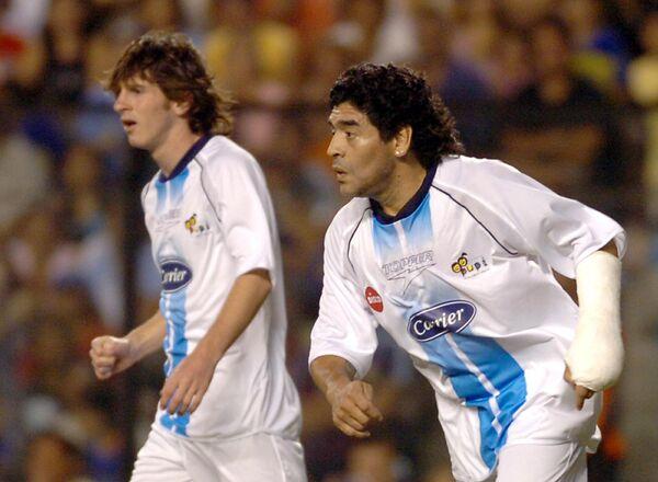 Лионель Месси и Диего Марадона (слева направо)